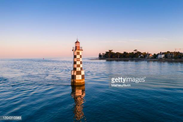 """aerial view of the sunset in loctudy in the front of """"perdrix"""" lighthouse - brest brittany stock pictures, royalty-free photos & images"""