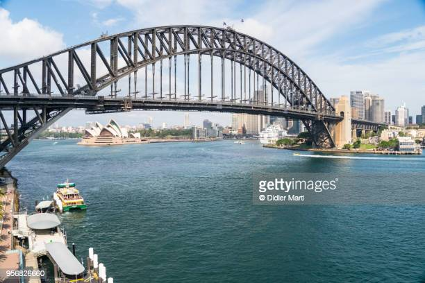 aerial view of the sydney harbor and cbd skyline in australia - sydney harbour bridge stock pictures, royalty-free photos & images