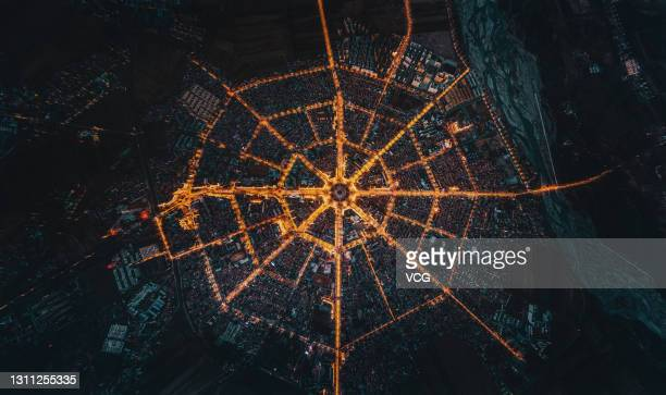Aerial view of the Tekes county in the shape of Bagua , eight symbols used in Taoist cosmology, being illuminated at night on April 3, 2021 in Tekes...