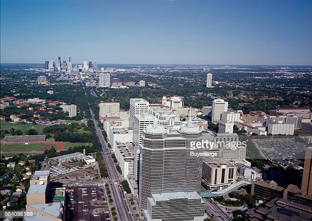 Aerial view of the Texas Medical Center with skyline of Houston in the background