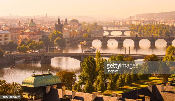 aerial view of the the charles bridge and vltava river in prague, czech republic - prague stock pictures, royalty-free photos & images
