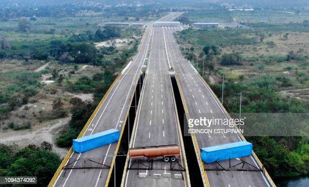 TOPSHOT Aerial view of the Tienditas Bridge in the border between Cucuta Colombia and Tachira Venezuela after Venezuelan military forces blocked it...