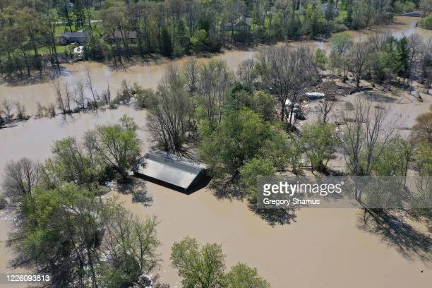 Aerial view of the Tittabawassee River after it breached a nearby dam on May 20, 2020 in Sanford, Michigan. Thousands of residents have been ordered...