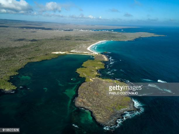 Aerial view of the Tortuga Bay area in Santa Cruz Island Galapagos Ecuador on January 21 2018 Ecuador's growing tourism threatens the country's...