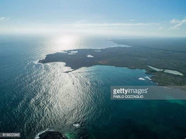 Aerial view of the Tortuga Bay area in Santa Cruz Island Galapagos Ecuador on January 21 2018 Ecuador's growing tourism threatens the country's...