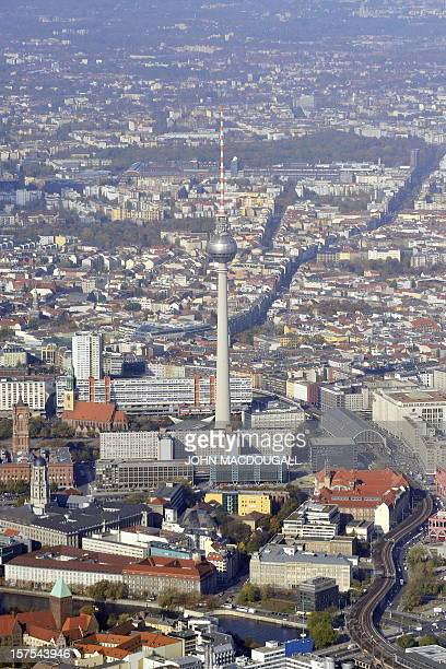 Aerial view of the TV Tower and central place Alexanderplatz taken through the window of a vintage Douglas DC3 aircraft known as a 'Rosinenbomber'...