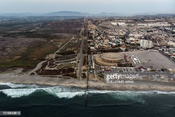 TOPSHOT Aerial view of the United States Mexico border fence extending into the Pacific ocean at Playas de Tijuana Baja California state Mexico on...