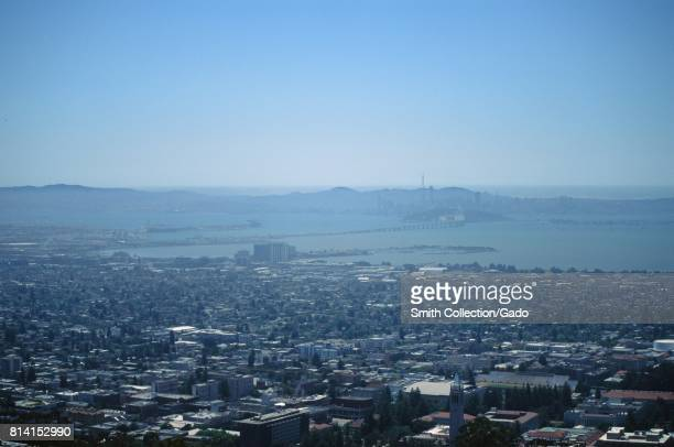 Aerial view of the University of California Berkeley Emeryville the San Francisco Bay and the Bay Bridge on a hazy day from the Berkeley Hills...