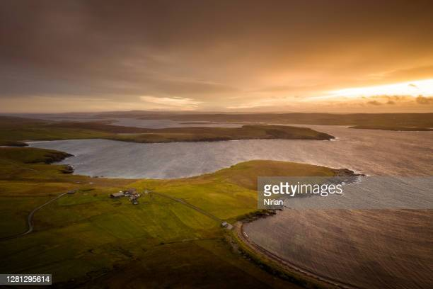 aerial view of the unst coast at sunset - island stock pictures, royalty-free photos & images