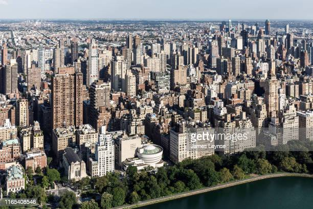 aerial view of the upper east side of manhattan - solomon r. guggenheim museum stock photos and pictures