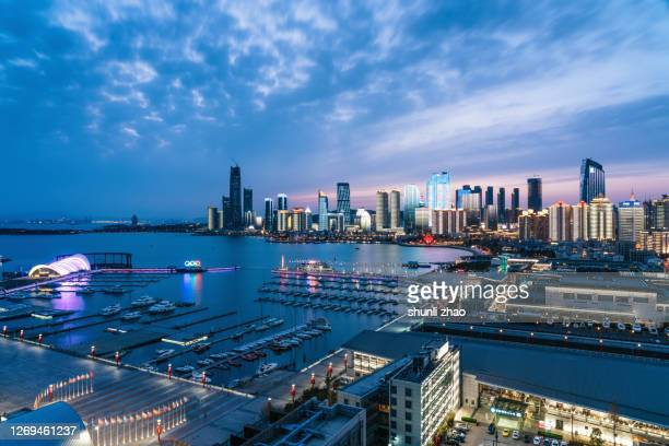 aerial view of the urban coastline - qingdao stock pictures, royalty-free photos & images