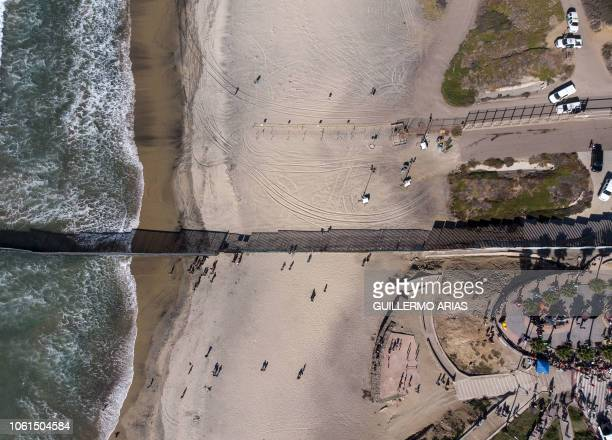 Aerial view of the US Mexico border divided by the border fence in Playas de Tijuana Mexico on November 14 as a group of Central American migrants...