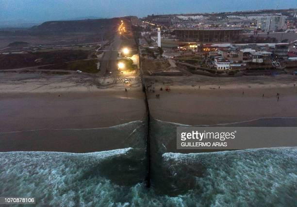 TOPSHOT Aerial view of the US Mexico border fence at Playas de Tijuana Baja California state Mexico on December 9 2018 Thousands of Central American...