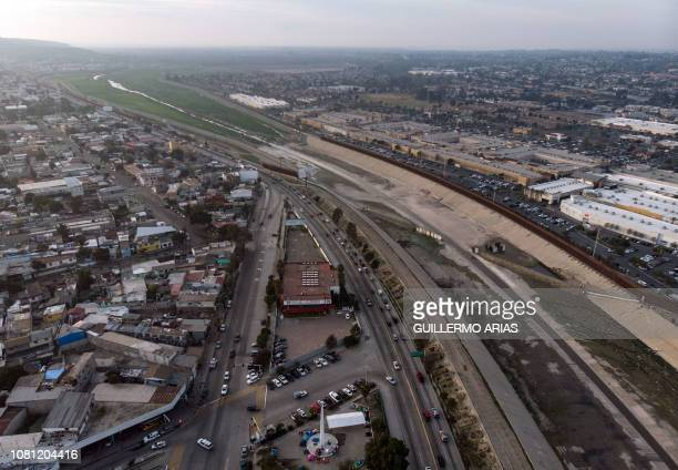 Aerial view of the USMexico border fence at the Tijuana River seen from Tijuana Baja California state on January 11 2019