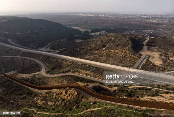 Aerial view of the USMexico border fence seen at Smugglers Canyon from Tijuana Baja California state on January 11 2019