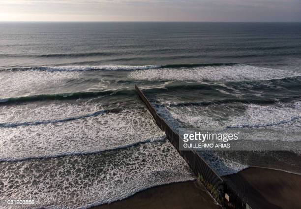 TOPSHOT Aerial view of the USMexico border fence seen from Playas de Tijuana Baja California state on January 11 2019