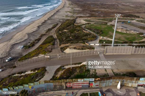 Aerial view of the USMexico border fence seen from Playas de Tijuana Baja California state on January 11 2019