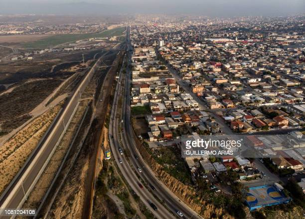 Aerial view of the USMexico border fence seen from Tijuana Baja California state on January 11 2019