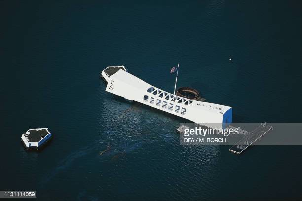 Aerial view of the USS Arizona Memorial, monument in memory of the USS Arizona battleship which was sunk during the Japanese attack on December 7...