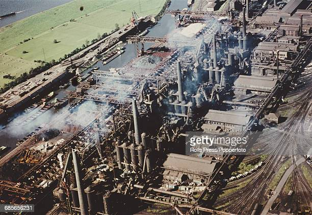 Aerial view of the vast Krupp steelworks and factory complex showing its connections to both the German rail and canal network in Essen West Germany...