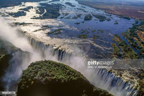 Aerial view of the Victoria Falls on the Zambezi River, Mosi-oa-Tunya National Park, Zambia, and Victoria Falls National Park, Zimbabwe.