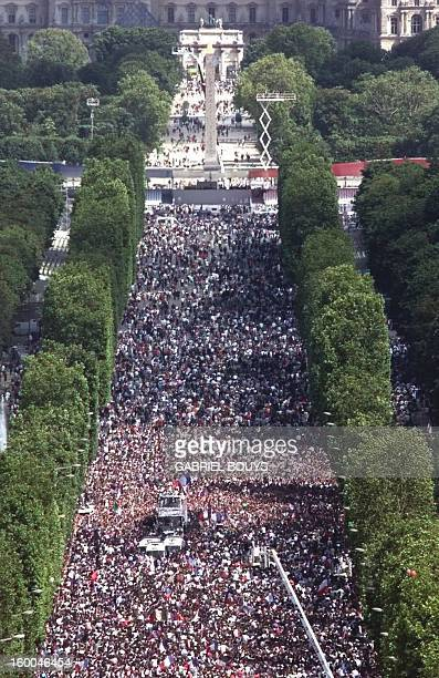 Aerial view of the victory parade on the Champs Elysees avenue 13 July by FIFA World Cup winners riding aboard an opentopped bus AFP PHOTO GABRIEL...