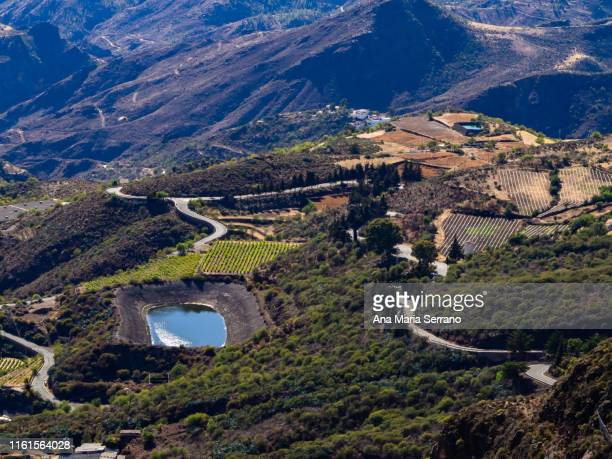 """aerial view of the village tejeda and the natural space """"risco caído and the sacred spaces of montaña de gran canaria"""", gran canaria island, canary islands, spain - tejeda canary islands stock pictures, royalty-free photos & images"""