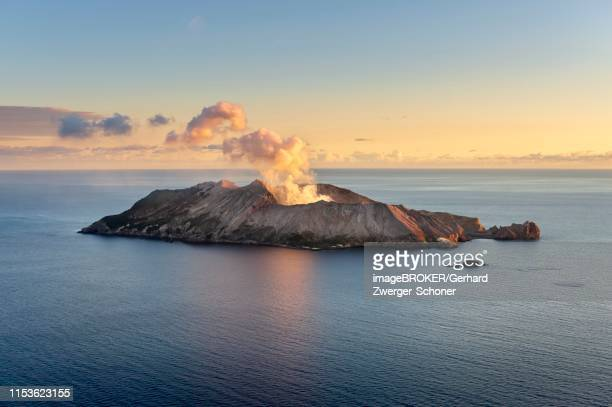 aerial view of the volcanic island white island with rising steam from the crater, morning mood, whakaari, volcanic island, bay of plenty, north island, new zealand - new zealand volcano stock photos and pictures