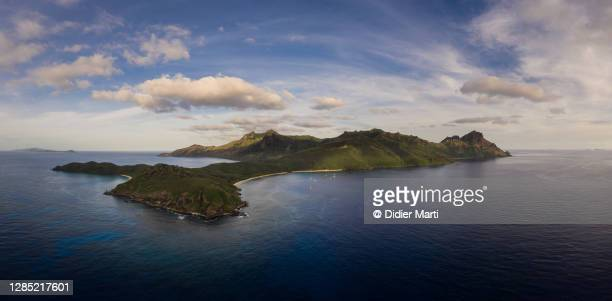 aerial view of the waya island and the blue lagoon beach in hte yasawa archipelago in fiji. - fiji stock pictures, royalty-free photos & images