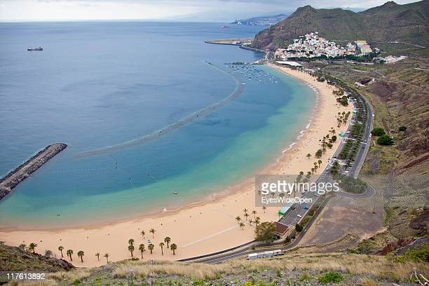 Aerial view of the white sandy beach with palmtrees Playa de las Teresitas which is made from sahara sand and called the most beautiful beach of the...