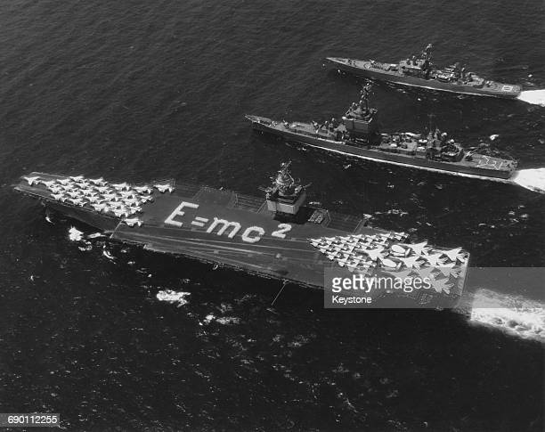 Aerial view of the world's first nuclearpowered aircraft carrier the USS Enterprise of the United States Navy with physicist Albert Einstein's E = mc...
