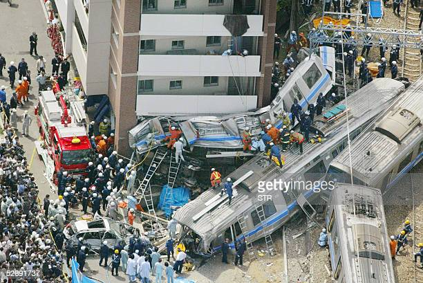 Aerial view of the wreckage of train carriages near an apartment building in Amagasaki Hyogo prefecture 25 April 2005 At least 16 people were killed...