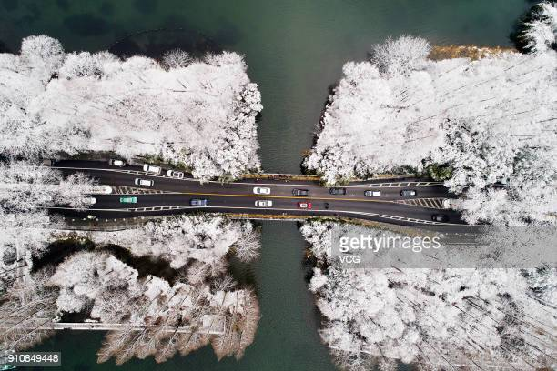 Aerial view of the Yang Gong Causeway on West Lake after a heavy snowfall on January 26 2018 in Hangzhou Zhejiang Province of China