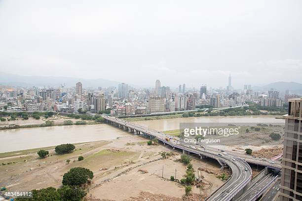 Aerial view of the Zhongzheng Bridge as it crosses the Xindian River in Taipei. Rain associated with typhoon Soudelor flooded the area, leaving piles...