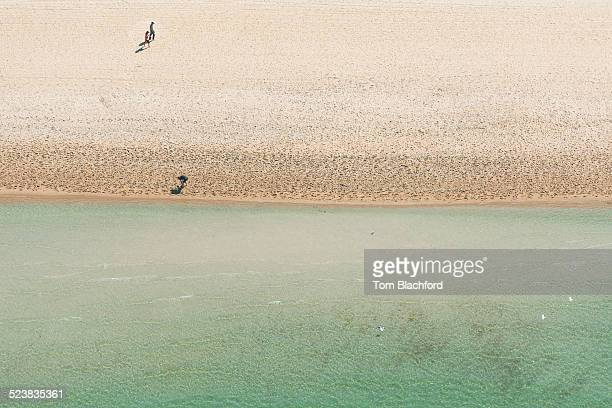 Aerial view of three holiday makers strolling on beach, Melbourne, Victoria, Australia