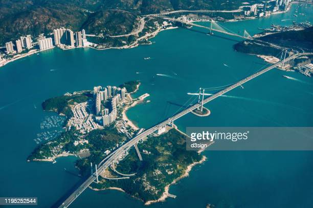 aerial view of ting kau bridge and tsing ma bridge connecting three islands in hong kong - paisajes de hongkong fotografías e imágenes de stock