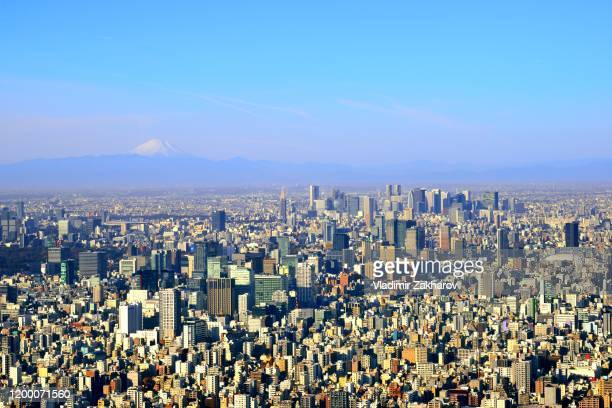 aerial view of tokyo and mount fuji - 丸の内 ストックフォトと画像