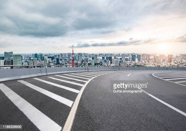 aerial view of tokyo at sunset - 路面表示 ストックフォトと画像