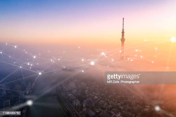 aerial view of tokyo city with networking connections line,global communications and technology concept,data and smart city and internet of things  concept,futuristic concept - 5g foto e immagini stock