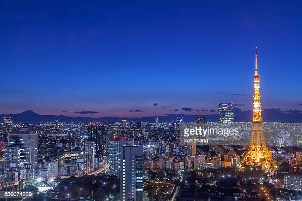 Aerial view of Tokyo city with Tokyo tower and MountFuji Japan at night