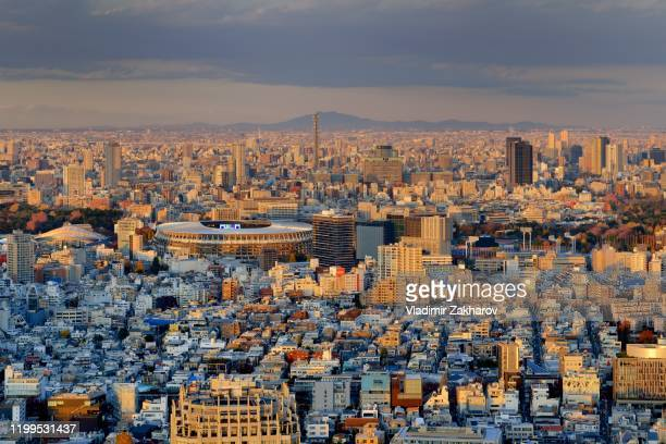 aerial view of tokyo cityscape at sunset - olympic stadium stock pictures, royalty-free photos & images