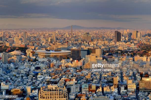 aerial view of tokyo cityscape at sunset - olympisk stadion bildbanksfoton och bilder