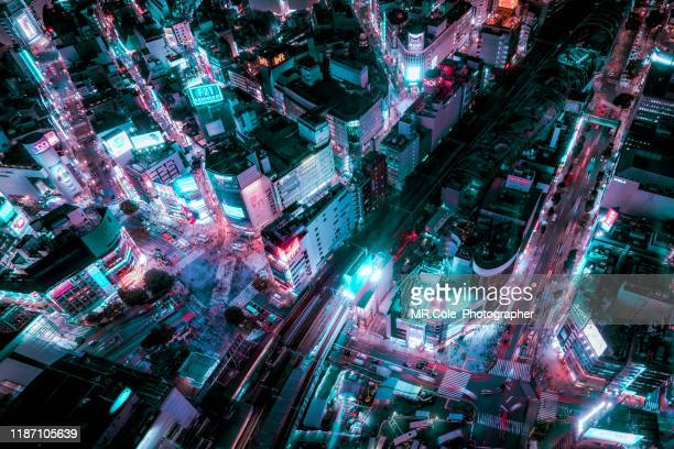 aerial view of tokyo cityscape in neon colored tone,technology futuristic city concept,smart city concept - financial technology stock pictures, royalty-free photos & images