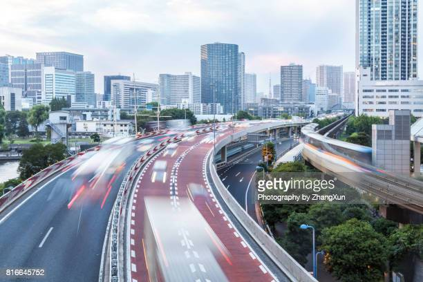 aerial view of tokyo cityscape with highway busy traffic at day time, tennoz isel, tokyo, japan. - overhead view of traffic on city street tokyo japan stock photos and pictures