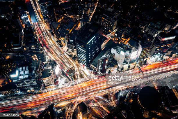 aerial view of tokyo highway at night - overhead view of traffic on city street tokyo japan stock photos and pictures
