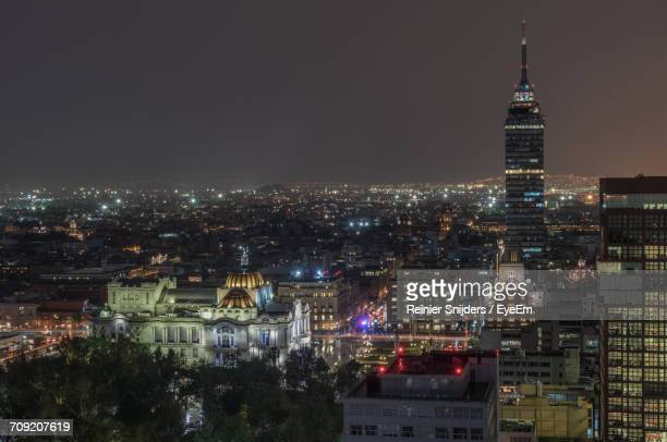 Aerial View Of Torre Latinoamericana And Palacio De Bellas Artes In City At Night Against Clear Sky