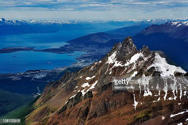 Aerial view of Torres del Paine. Aerial view of Andes Mountains in Tierra del Fuego with Ushuaia in background. Tierra del Fuego National Park, Argentina
