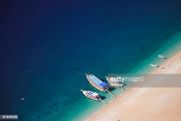 aerial view of tour boats moored at oludeniz beach, fethiye, turkey - ali kabas stock pictures, royalty-free photos & images