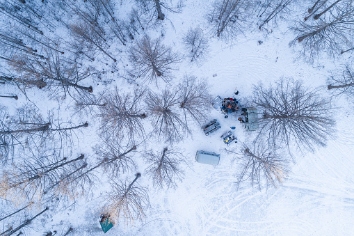 aerial view of tourist group with campfire in the pine forest in winter - gettyimageskorea