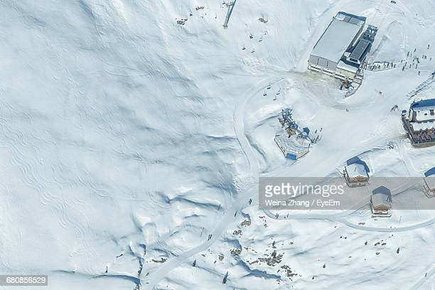 Aerial View Of Tourist Resorts At Swiss Alps During Winter